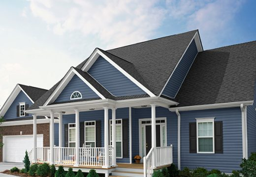 House with blue Compass lap vinyl siding
