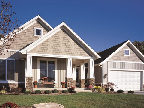 House with tan board and batten siding